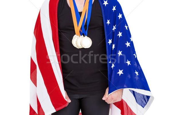 Atléta aranyérem tart amerikai zászló fehér férfi Stock fotó © wavebreak_media