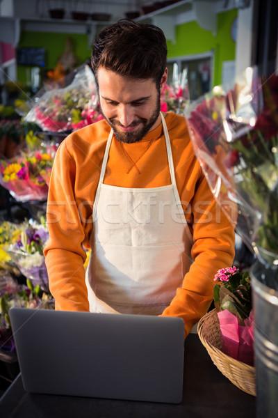 Erkek çiçekçi çalışma dizüstü bilgisayar bilgisayar Stok fotoğraf © wavebreak_media