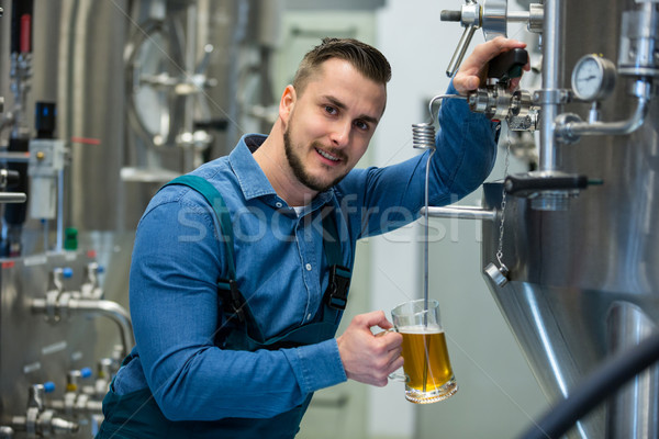 Brewer testing beer from tank Stock photo © wavebreak_media