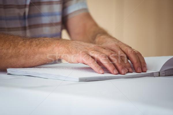 Senior man using braille to read Stock photo © wavebreak_media