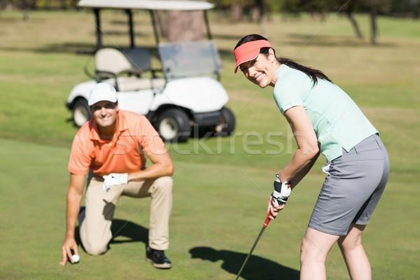 портрет улыбающаяся женщина играет гольф Постоянный человека Сток-фото © wavebreak_media