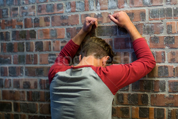 Stressed man leaning on wall in building Stock photo © wavebreak_media