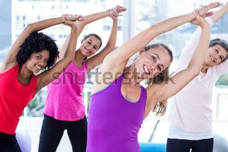 Instructor taking yoga class Stock photo © wavebreak_media