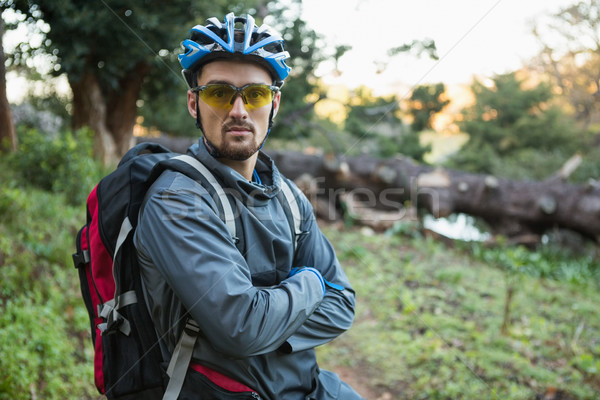 Portrait of male mountain biker with arms crossed in the forest Stock photo © wavebreak_media