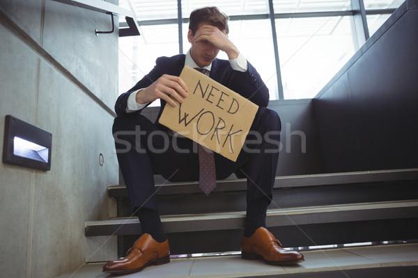 Déprimée affaires séance escaliers carton Photo stock © wavebreak_media
