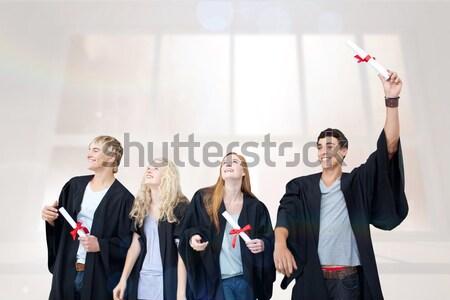 три студентов выпускник халат оружия белый Сток-фото © wavebreak_media