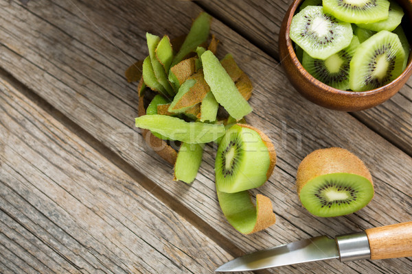 Rebanadas kiwi mesa de madera madera cuchillo desayuno Foto stock © wavebreak_media