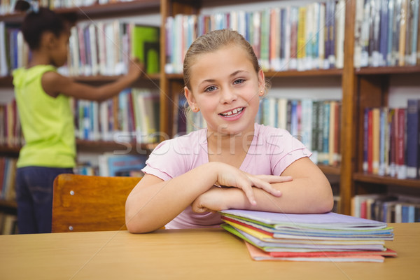 Smiling student sitting at a table Stock photo © wavebreak_media