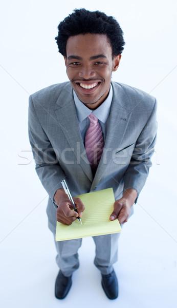High angle of businessman writing notes Stock photo © wavebreak_media