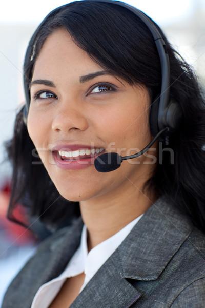 Retrato empresária falante fone étnico escritório Foto stock © wavebreak_media