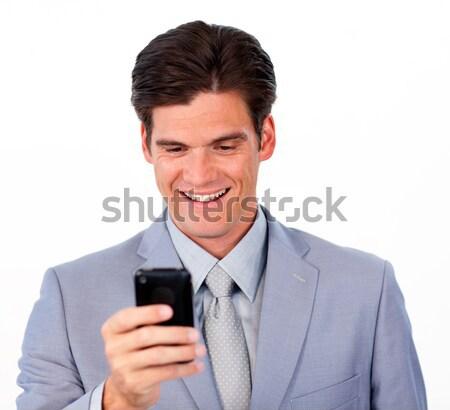 Positive businessman sending a message a newspaper Stock photo © wavebreak_media
