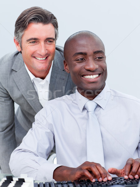 Stock photo: Two cheerful businessman working at a computer