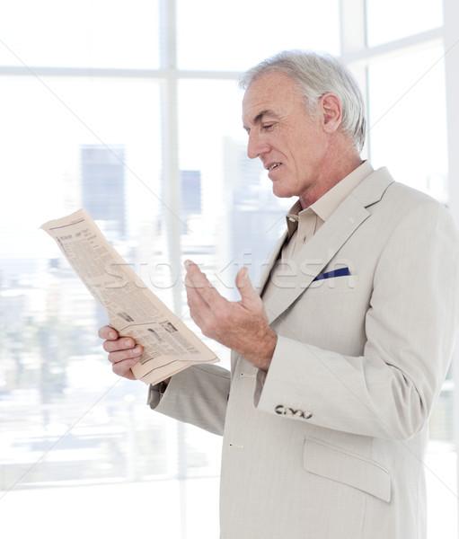 Portrait of a mature manager reading newspaper Stock photo © wavebreak_media