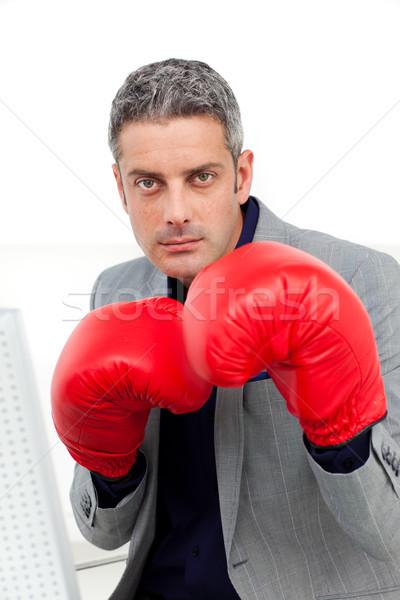 Karizmatikus üzletember boxkesztyűk iroda kéz szem Stock fotó © wavebreak_media
