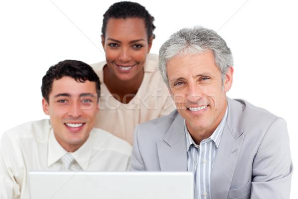 Charismatique affaires utilisant un ordinateur portable blanche femme Photo stock © wavebreak_media