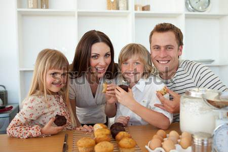 Family watching television and eating chips Stock photo © wavebreak_media