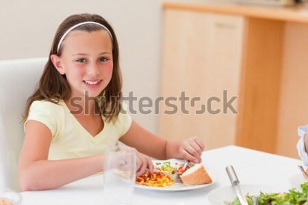 Jolly woman having breakfast  Stock photo © wavebreak_media