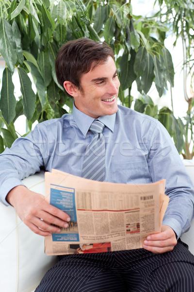 Relaxed businessman reading a newspaper Stock photo © wavebreak_media