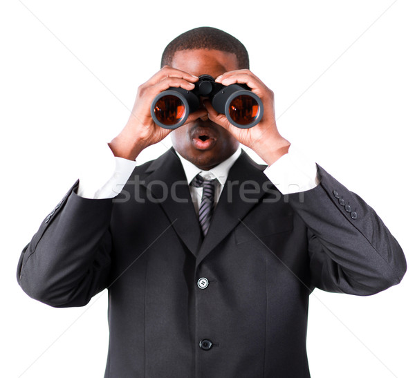Close-up of an young businessman with binoculars  Stock photo © wavebreak_media