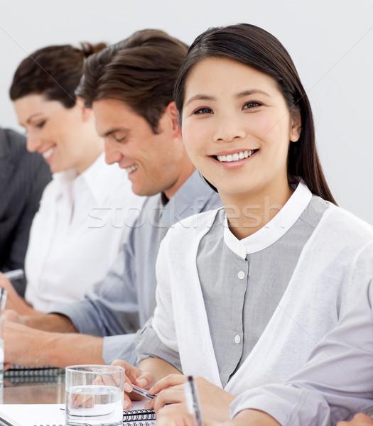 Souriant femme d'affaires réunion équipe regarder caméra Photo stock © wavebreak_media