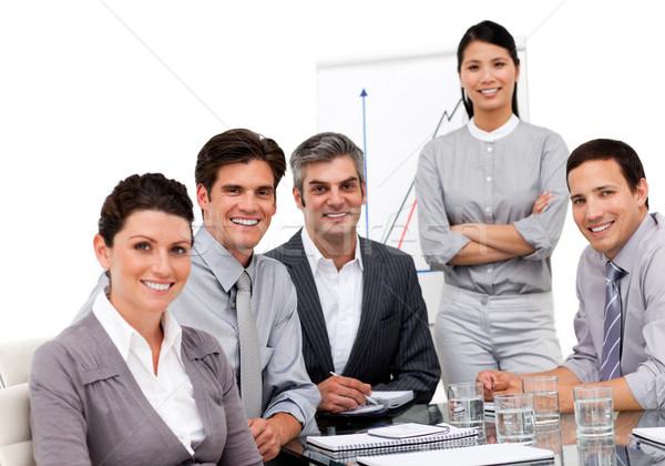 Portret zespół firmy posiedzenia wraz biały kobieta Zdjęcia stock © wavebreak_media