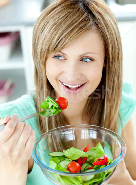 Cute woman eating a salad in the kitchen  Stock photo © wavebreak_media
