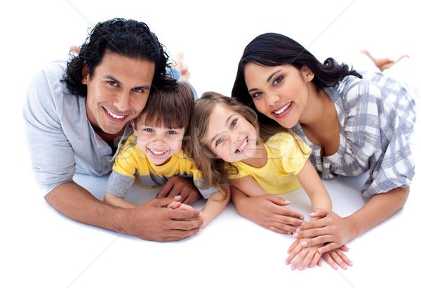 Lively family lying on the floor against a white background Stock photo © wavebreak_media
