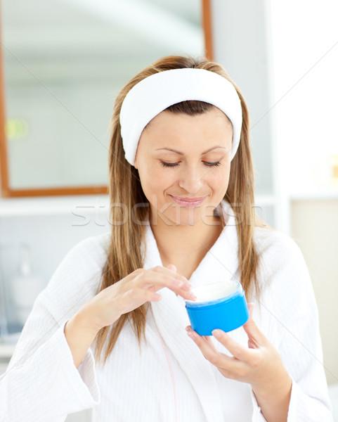 Bastante mulher jovem creme banho robe Foto stock © wavebreak_media