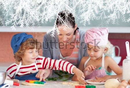 Happy young family at the beach in the sun Stock photo © wavebreak_media