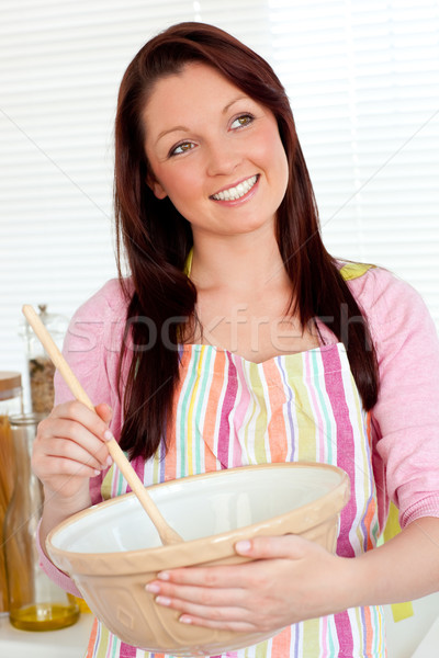 Positive woman cooking at home in the kitchen Stock photo © wavebreak_media