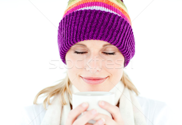 Delighted woman wearing a white pullover and a colorful hat against a white background Stock photo © wavebreak_media