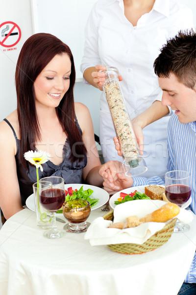 Feliz casal jantar restaurante garçom pimenta Foto stock © wavebreak_media