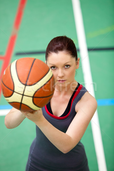 Portrait of a concentrated young woman playing basket-ball in a gymnasium Stock photo © wavebreak_media
