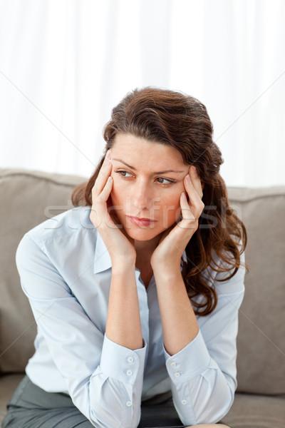 Agotado mujer de negocios sesión sofá casa medicina Foto stock © wavebreak_media