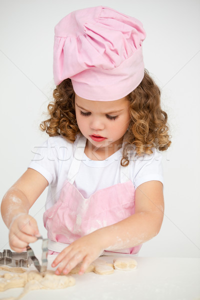 Cute little girl making biscuit at a table in the kitchen Stock photo © wavebreak_media