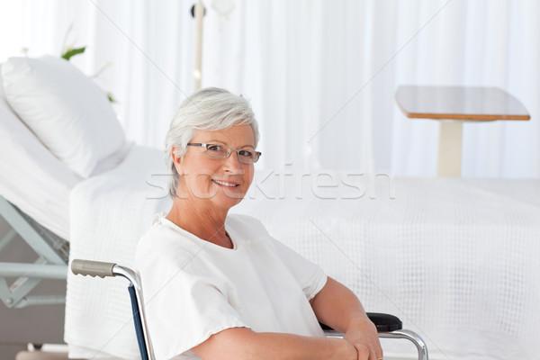 Senior mulher cadeira de rodas olhando câmera espaço Foto stock © wavebreak_media
