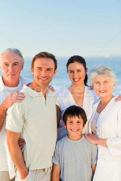 Radiant family at the beach Stock photo © wavebreak_media