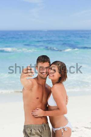 Man carrying his wife at the beach Stock photo © wavebreak_media