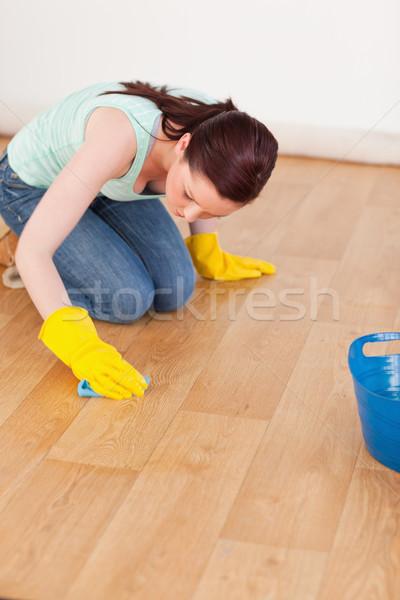 Csinos nő takarítás padló térdel otthon Stock fotó © wavebreak_media