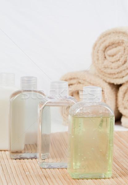 Close up of massage oils and towels Stock photo © wavebreak_media