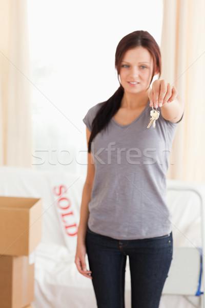 Retrato mulher teclas sala de estar negócio Foto stock © wavebreak_media