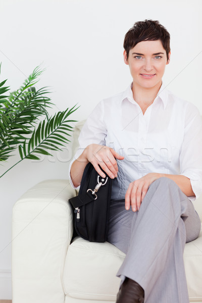 Imprenditrice seduta divano sala di attesa donna fiore Foto d'archivio © wavebreak_media