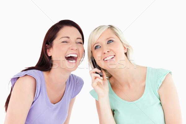 éljenez nők telefon stúdió mosoly boldog Stock fotó © wavebreak_media