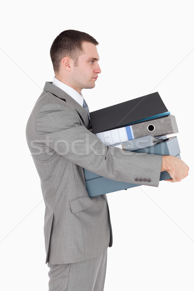 Portrait of a businessman holding a stack of binders against a white background Stock photo © wavebreak_media