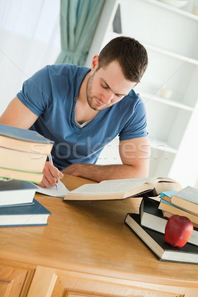 Erkek öğrenci odaklı çalışmak kâğıt okul Stok fotoğraf © wavebreak_media
