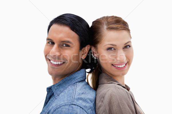 Zijaanzicht glimlachend paar permanente Maakt een reservekopie witte Stockfoto © wavebreak_media