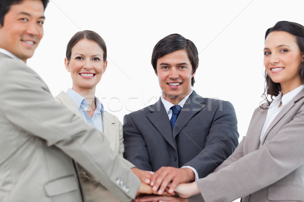 Young salesteam motivating each other against a white background Stock photo © wavebreak_media