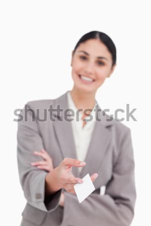 Business card being handed over by smiling saleswoman against a white background Stock photo © wavebreak_media
