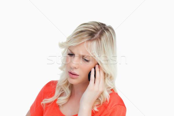 Komoly vonzó nő beszél mobiltelefon fehér szomorú Stock fotó © wavebreak_media