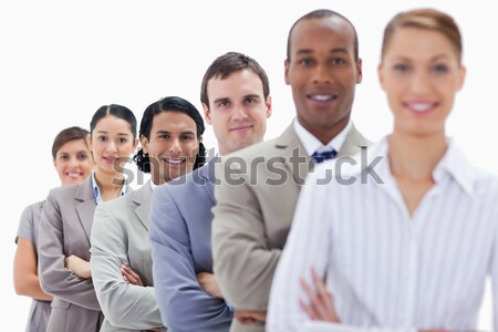 Close-up of a business team crossing their arms in a single line with focus on the first two people Stock photo © wavebreak_media